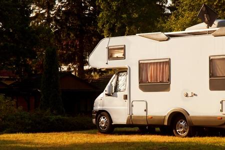 White caravan camper travel car on campsite