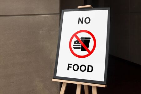 banned: Frame and easel stand tripod with no food poster Stock Photo