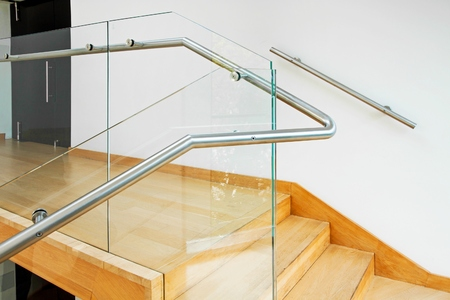 staircase: Modern architecture interior with elegant wooden stairs and glass balustrade