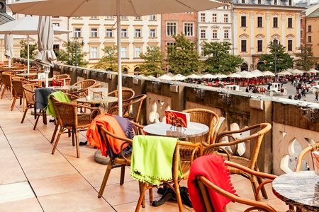 Sukiennice terrace cafe in Cracow with tables and chairs