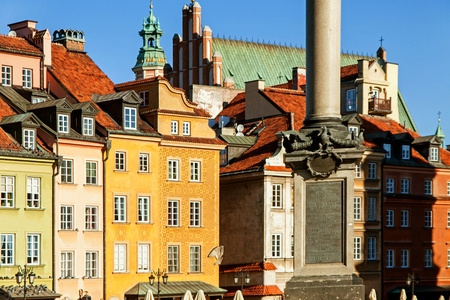 Old town architecture square landmark in warsaw with column and castle