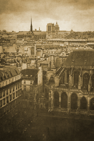 Vintage retro old styled paris sepia photography with notre dame cathedral