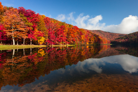 serene landscape: Autumn on Sherando Lake Recreation Area in the George Washington National Forest.