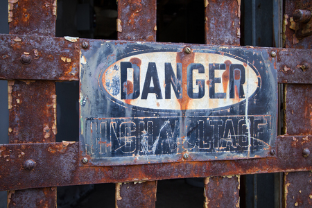 penitentiary: Rusty metal High Valtage sign located in Eastern State Penitentiary in Philadelphia, Pennsylvania