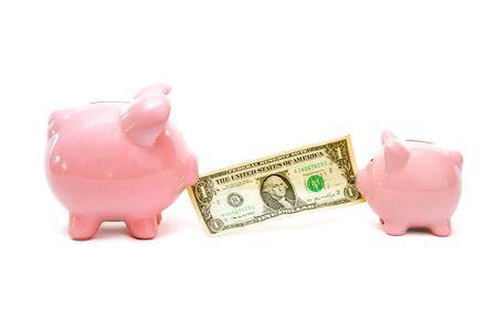 tog: Two pink piggy banks having an tog of war over dollar bill.