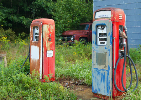 abandoned gas station: Old gas pumps at an abandoned gas station.