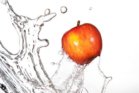 Red delicious apple splashing through fresh water. Stock Photo - 49175919