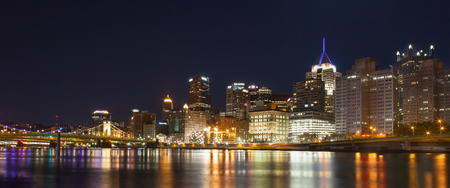 allegheny: Pittsburgh, Pennsylvania skyline at night overlooking the Allegheny River with the Andy Warhol Bridge and Roberto Clemente Bridge in background. Stock Photo