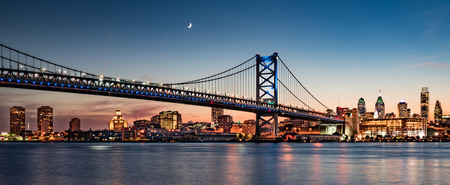 Philadelphia skyline and Benjamin Franklin Bridge at dusk as seen from Camden, New Jersey