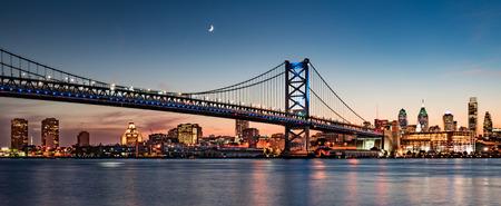 modern bridge: Philadelphia skyline and Benjamin Franklin Bridge at dusk as seen from Camden, New Jersey