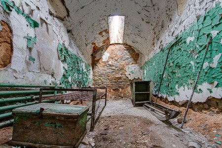 penitentiary: Prison cell in Eastern State Penitentiary,  also known as ESP, is a former American prison in Philadelphia, Pennsylvania. Stock Photo