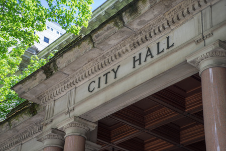 architecture and buildings: City Hall sign on the front of building.