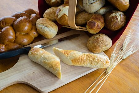 processed grains: Collection of breads including Challah, baguettes and rolls