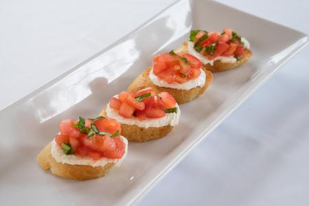 healthy snack: Tomato, basil  mozzarella bruschetta on toast Stock Photo