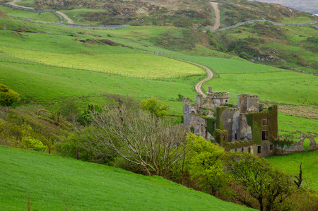 Clifden Castle is a ruined manor house west of the town of Clifden in the Connemara region of County Galway, Ireland. It was built circa 1818 for John DArcy, the local landowner, in the Gothic Revival style. Uninhabited after 1894.
