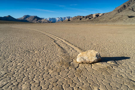 inscribe: The Racetrack Playa, or The Racetrack, is a scenic dry lake feature with sailing stones that inscribe linear racetrack imprints. It is located above the northwestern side of Death Valley, in Death Valley National Park, Inyo County, California, U.S.