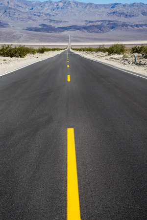 landscape mode: Long straight road in the desert of Death Valley, California