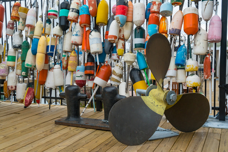 buoys: Collection of Lobster Buoys Hanging on a Fence with propeller