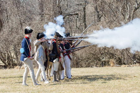 revolutionary: VALLEY FORGE, PA - FEBRUARY 2012: Revolutionary War soldiers fire muskets at a reenactment in Valley Forge National Historic Park