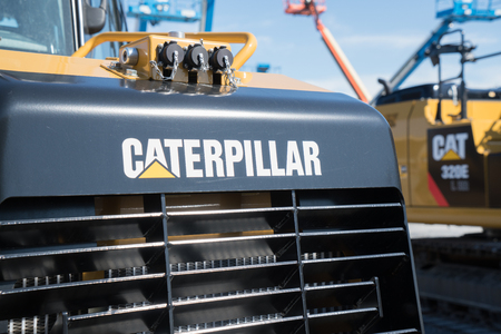 Litiz, PA, USA - April 23, 2016: Caterpillar heavy equipment lined up at Caterpillar dealer. Caterpillar is one of the largest manufacturers of heavy construction & mining equipment in the world.