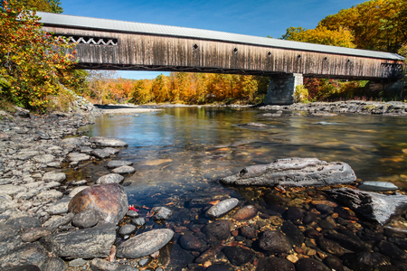 west river: Autunm color at the West Dummerston Covered Bridge over the West River in Dummerston, Vermont. Stock Photo