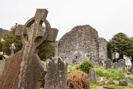 monastic: Irish cemetary at Gledalough Monastic City.  The site is an early Christian monastic settlement was founded by St. Kevin in the 6th century