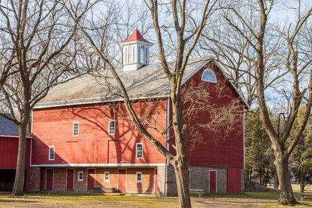 old red barn: Old red barn with cupola on top