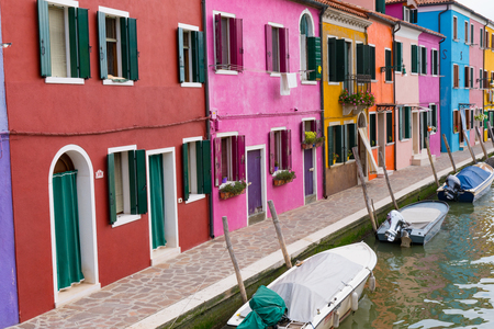 Colorful homes along a canal in Burano, Italy Imagens