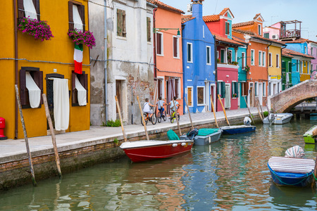 Colorful homes along a canal in Burano, Italy Stock Photo