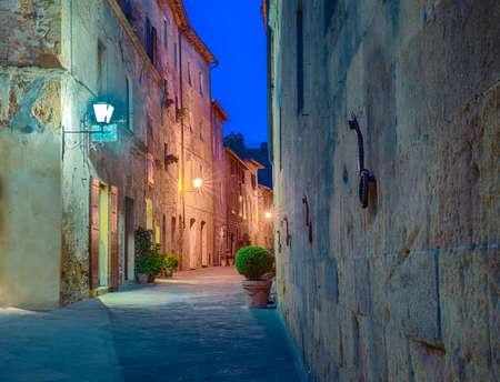 Street in Pienza, Italy at night. Stock Photo