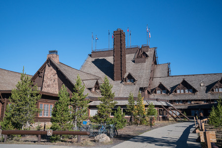 YELLOWSTONE, WY - SEPTEMBER 27: Exterior of the historic Old Faithful Inn in Yellowstone National Park, Wyoming.  Built in 1904, the inn is considered to be the largest log structure in the world. Editorial