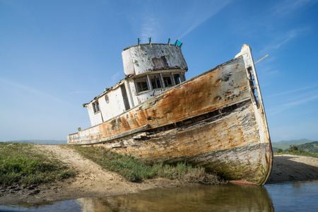 Old boat wrecked on the sand along Point Reyes, California
