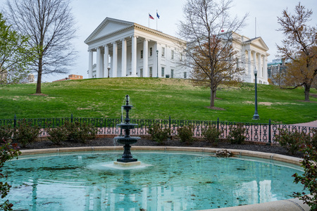 Morning at the Virginia state capitol building in Richmond with fountain in the foreground.