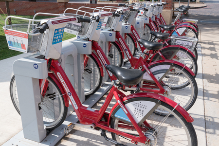 shared sharing: Red bicycles lined up at Fort Worth, Texas Bike Share Station on May 11, 2017 Editorial