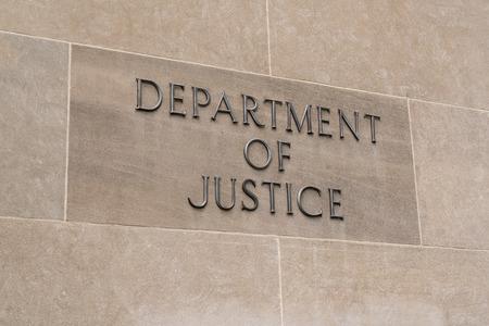 WASHINGTON, DC - JULY 12: United States Department of Justice sign in Washington, DC on July 12, 2017 Banco de Imagens - 83708396