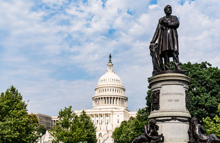President James Garfield Monument with United States Capitol Building in Washington, DC Stock Photo