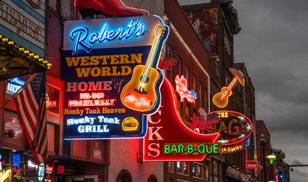 NASHVILLE, TN - OCT 8: Neon signs light the strip along Broadway on October 8, 2017 in Nashville, Tennessee, USA