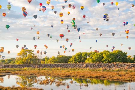 ALBUQUERQUE, NM - OCTOBER 13: Balloons fly over Albuquerque during Albuquerque Balloon Festival on October 13, 2017