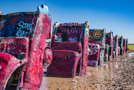 AMARILLO, TX-OCTOBER 12: Old Cadillac cars burried at the famous Cadillac Ranch Ranch along historic Route 66 near Amarillo, TX on October 12, 2017