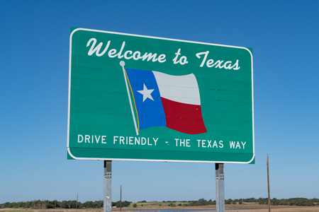 Welcome to Texas Sign on the road at the state border Banco de Imagens - 90699259