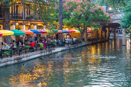 SAN ANTONIO, TX - OCTOBER 27, 2017: Visitors dine along the Riverwalk in San Antonio, Texas