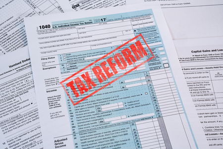 IRS 1040 Tax Form with red Tax Reform Stamp