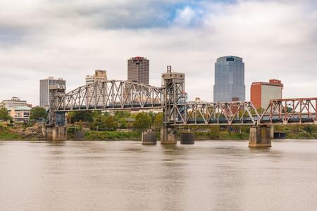 LITTLE ROCK, AR - OCTOBER 11, 2017:  Little Rock Junction Bridge and city skyline from across the Arkansas River
