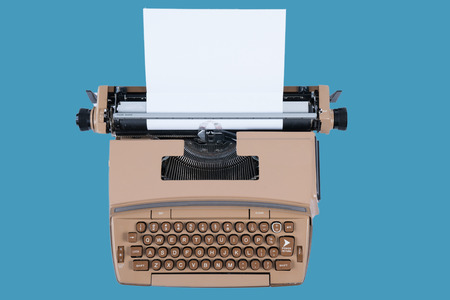 Old Vintage Typewriter with paper isolated on a blue background