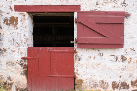 Old Red Door On Whitewashed Stone Barn Stock Photo   100450260