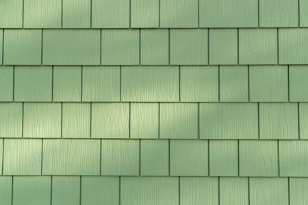 Hintergrund der Wand mit grünen Zedernschindeln