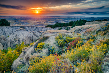 Zonsopgang boven Badlands National Park, South Dakota Stockfoto