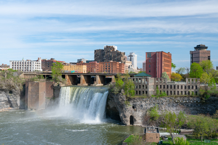 ROCHESTER, NY: Skyline of Rochester, New York at the High Falls along the Genesee River Editorial