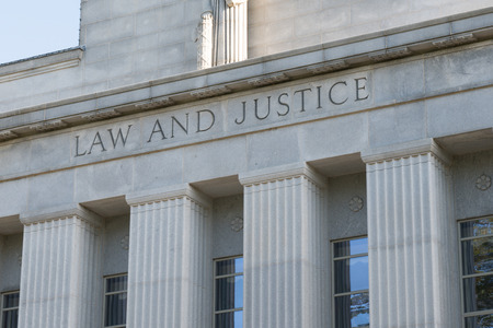 Stone Facade of Courthouse with Law and Justice