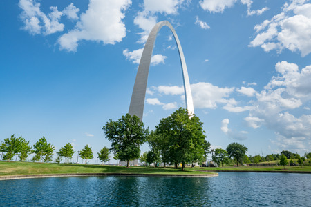 St Louis Gateway Arch in Missouri along the pond Editorial